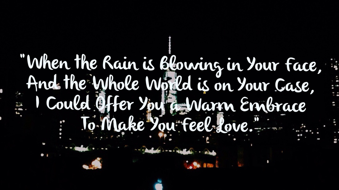 Colored Photograph of New York City at Night with Lyrics from Make You Feel My Love by Adele.